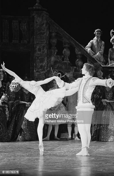 Russian dancer and choreographer Rudolf Nureyev dances with a ballerina during his 1976 production of Tchaikovsky's The Sleeping Beauty at the Palais...