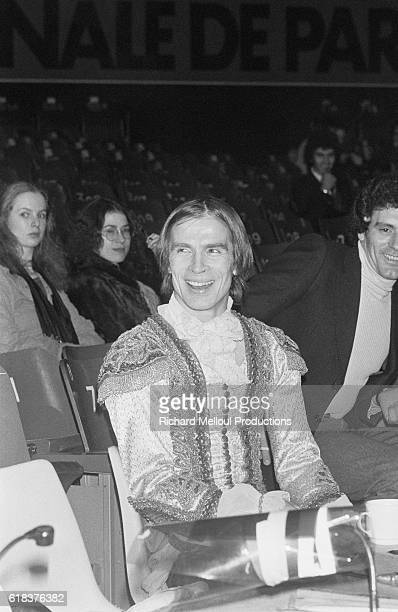 Russian dancer and choreographer Rudolf Nureyev sits near the audience during his 1976 production of Tchaikovsky's The Sleeping Beauty at the Palais...
