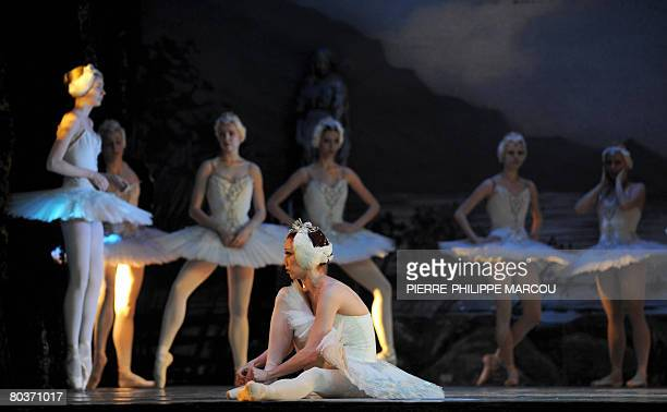 Russian dancer Ekatarina Berezina adjusts her shoe during the rehearsal of Pyotr Tchaikovsky's ballet 'Swan Lake' in Madrid on March 25 2008 AFP...