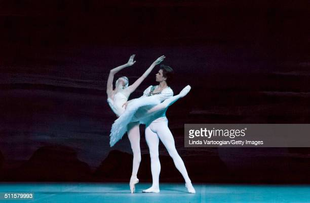 Russian dancers Anna Nikulina and Artem Ovcharenko perform during Act I in the Bolshoi Ballet production of 'Swan Lake' during the Lincoln Center...