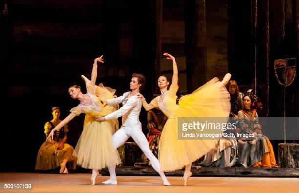 Russian dancers Artem Ovcharenko , Maria Vinogradova and Kristina Kretova in the Bolshoi Ballet production of 'Swan Lake' during the Lincoln Center...