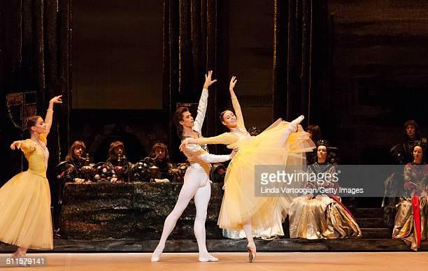 Russian dancers Maria Vinogradova and Kristina Kretova perform with Artem Ovcharenko in the Bolshoi Ballet production of 'Swan Lake' during the...