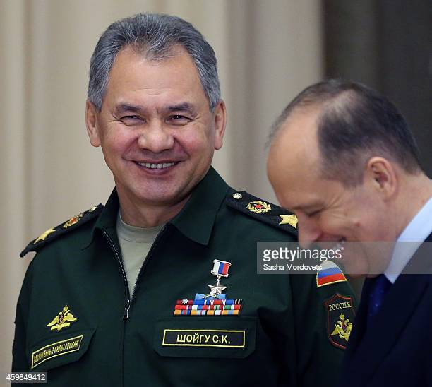 Russian Defence Minister Sergei Shoigu and FSB Chief Alexander Bortnikov attend a meeting with military commanders and other officials of Russian...