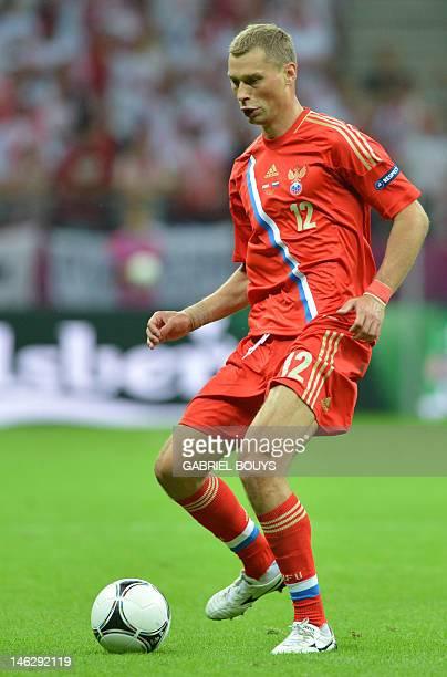 Russian defender Aleksei Berezutski controls the ball during the Euro 2012 championships football match Poland vs Russia on June 12 2012 at the...