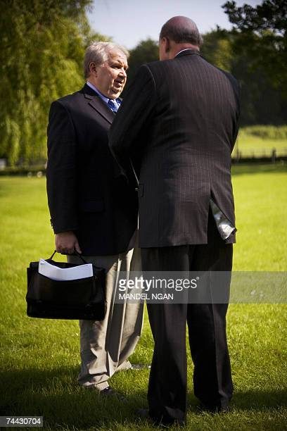 Russian Deputy Foreign Minister Sergei Kislyak speaks with US Deputy Secretary of State John Negroponte after US President George W Bush and Russian...