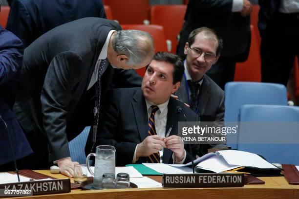 CORRECTION Russian Deputy Permanent Representative to the UN Vladimir Safronkov speaks with Syrian Ambassador to the UN Bashar Jaafari before they...