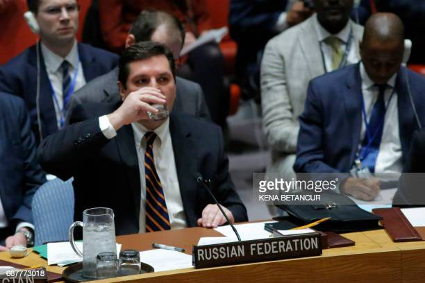 Russian Deputy Permanent Representative to the United Nations Vladimir Safronkov drinks water at the end of his speech after he voted against a Draft...
