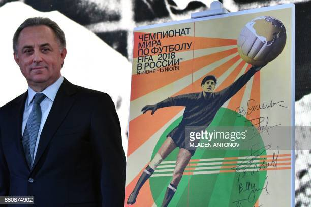 Russian deputy prime minister Vitaly Mutko chairman of the 2018 FIFA World Cup Russia Local Organizing Committee stands by the official poster for...