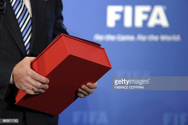 Russian deputy primeminister Igor Shuvalovs' holds a Russian World Cup football bid book during an official handover ceremony at FIFA's headquarters...