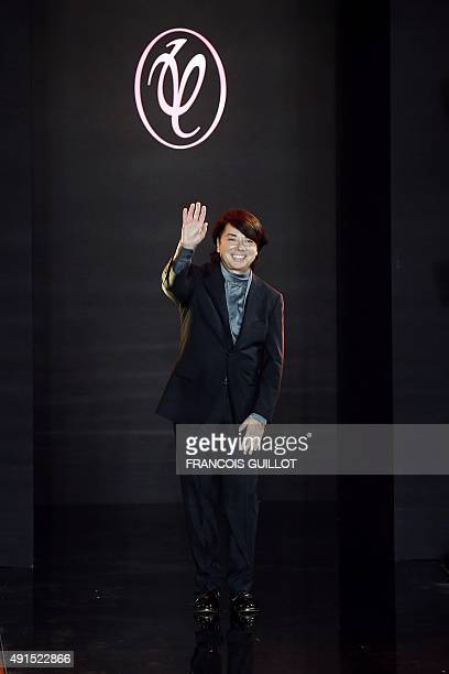 Russian designer Valentin Yudashkin acknowledges the public at the end of his 2016 Spring/Summer ready-to-wear collection fashion show, on October 6,...