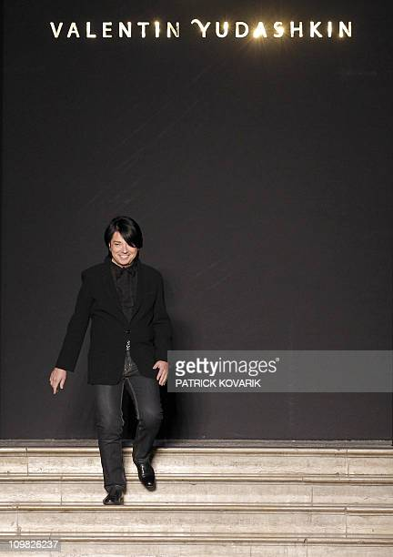 Russian designer Valentin Yudashkin acknowledges the public following the Autumn/Winter 2011-2012 ready-to-wear collection show on March 7, 2011 in...