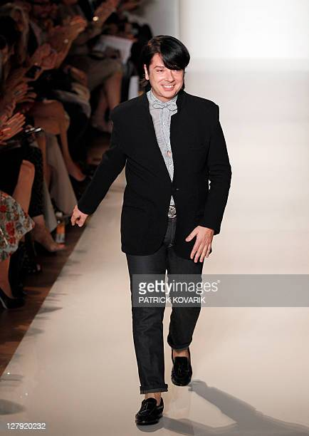 Russian designer Valentin Yudashkin acknowledges the public following his Spring/Summer 2012 ready-to-wear collection show, on October 3, 2011 in...