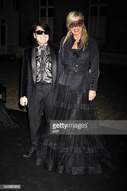 Russian designer Valentin Yudashkin poses with an unidentified woman in Paris, on September 30 prior to a party organized to celebrate the 90th...