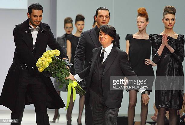 Russian designer Valentin Yudashkin walks on the catwalk at the end of the presentation of his collection during the fashion week on March 21, 2009...