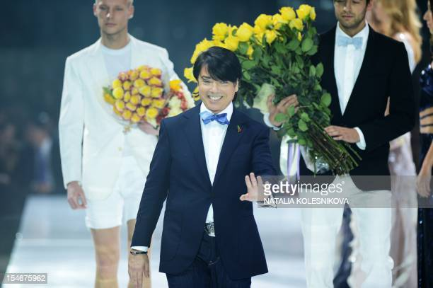 Russian designer Valentin Yudashkin walks on the podium after his opening show at the during Moscow Fashion Week in Moscow, on October 24, 2012. The...