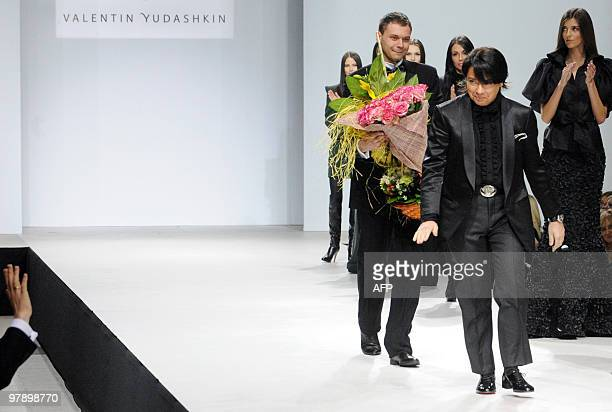 """Russian designer Valentin Yudashkin waves to a fan after his show in Moscow on March 20, 2010 at the opening of """"Volvo Fashion Week in Moscow"""". AFP..."""