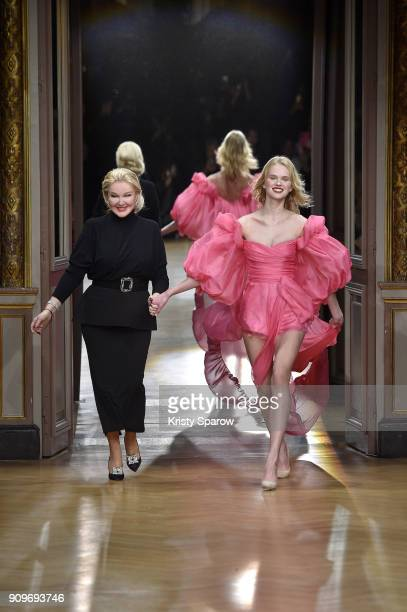 Russian Designer Yulia Yanina acknowledges the audience with a model during the Yanina Couture Spring Summer 2018 show as part of Paris Fashion Week...