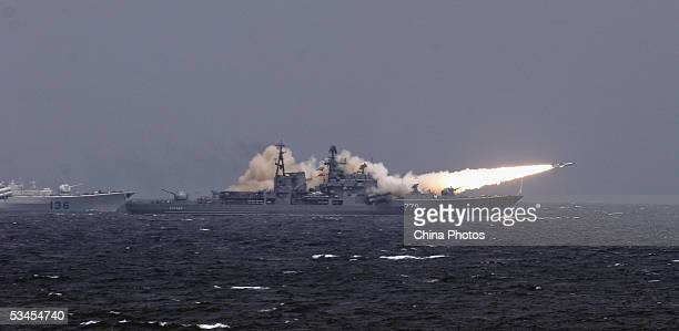 """Russian destroyer launches a ship-to-ship missile in an offshore blockade exercise during the third phase of the Sino-Russian """"Peace Mission 2005""""..."""