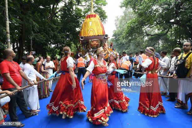 Russian Devotee part in the Traditional Russian folk dance during ISKCON 46th Ultta Rath Yatra on July 032017 in Kolkata IndiaThe three deities of...