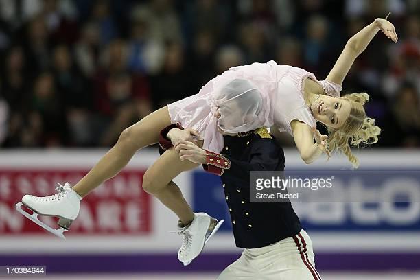 Russian Dimitri Soloviev gets lost in Ekaterina Bobrova's long skirt during the ice dance short program at the ISU World Figure Skating Championships...