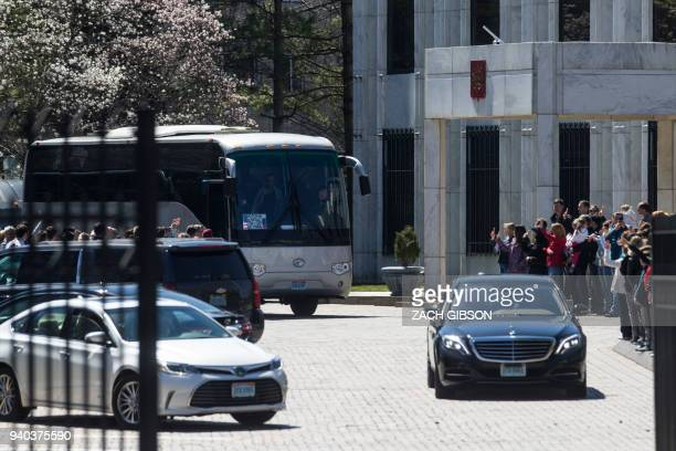 Russian diplomats expelled by the US after a nerve agent attack on a former spy leave their embassy in Washington DC March 31 2018 Along with the...