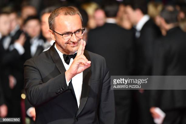 Russian director and member of the Feature Film Jury Andrey Zvyagintsev gestures as he arrives on May 9 2018 for the screening of the film 'Leto ' at...