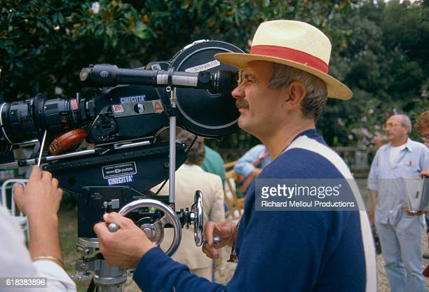 Russian director Nikita Mikhalkov looks through the camera while filming his 1987 Italian movie Oci Ciornie The movie which starred Marcello...