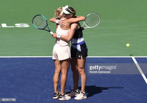 Russian doubles partner Ekaterina Makarova and Elena Vesnina of Russia celebrate after defeating Timea Babos of Hungary and Kristina Mladenovic of...