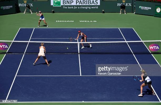 Russian doubles partners Ekaterina Makarova and Elena Vesnina of Russia take on Timea Babos of Hungary and Kristina Mladenovic of France during Day 9...