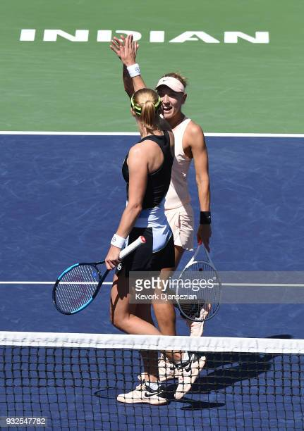 Russian doubles partners Ekaterina Makarova and Elena Vesnina of Russia celebrate after defeating Timea Babos of Hungary and Kristina Mladenovic of...