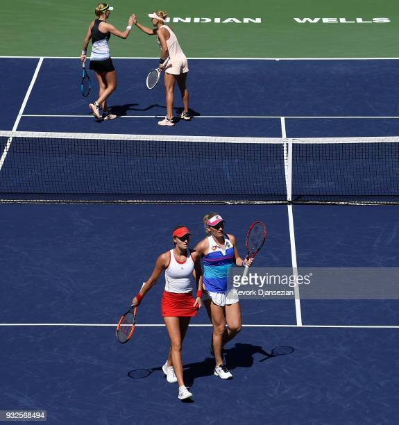 Russian doubles partners Ekaterina Makarova and Elena Vesnina of Russia celebrate after winning a game against Timea Babos of Hungary and Kristina...