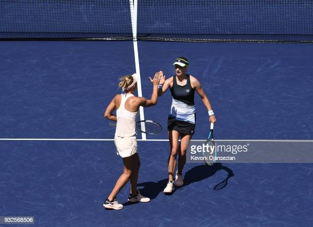 Russian doubles partners Ekaterina Makarova and Elena Vesnina of Russia take celebrate after winning a point against Timea Babos of Hungary and...