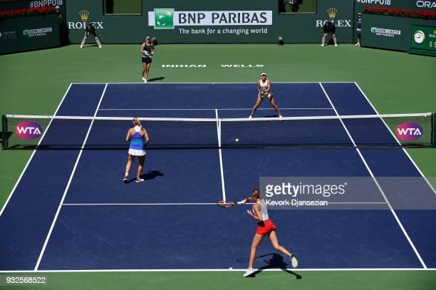 Russian doubles partners Ekaterina Makarova and Elena Vesnina of Russia battle Timea Babos of Hungary and Kristina Mladenovic of France during Day 11...