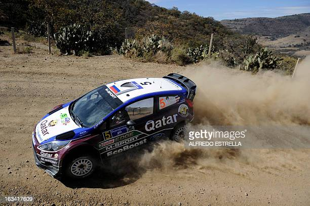 Russian driver Evgeny Novikov of Qatar Msport World Rally Team competes during the second day of the FIA World Rally Championship at the Speedway of...
