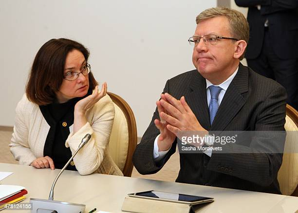 Russian economist Alexei Kudrin and Central Bank Chairman Elvira Nabiullina attend a meeting with ministers on economic on March 12 2014 in Sochi...