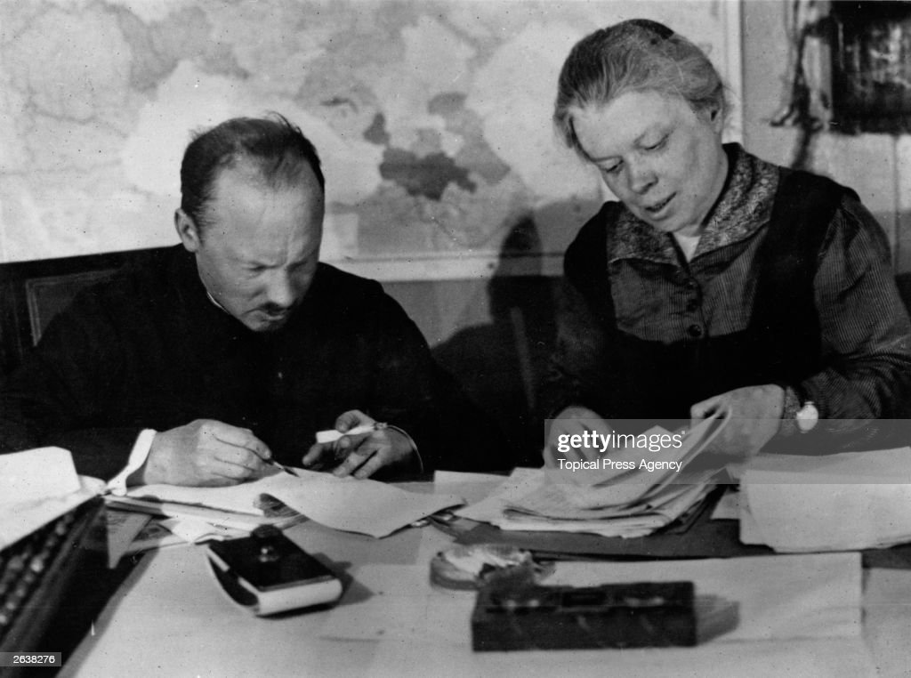 Russian economist and politician Nicholay Bukharin (1888 - 1938) sitting with Lenin's sister Maria Illyicthana Ulyanova. Both are prominent members of the editorial staff of 'Pravda'. Original Publication: People Disc - HA0212