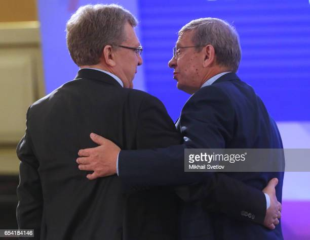 Russian economust Alexey Kudrin talks to billionaire Vladimir Yevtushenkov during the plenary session of the Congress of Russian Union of...