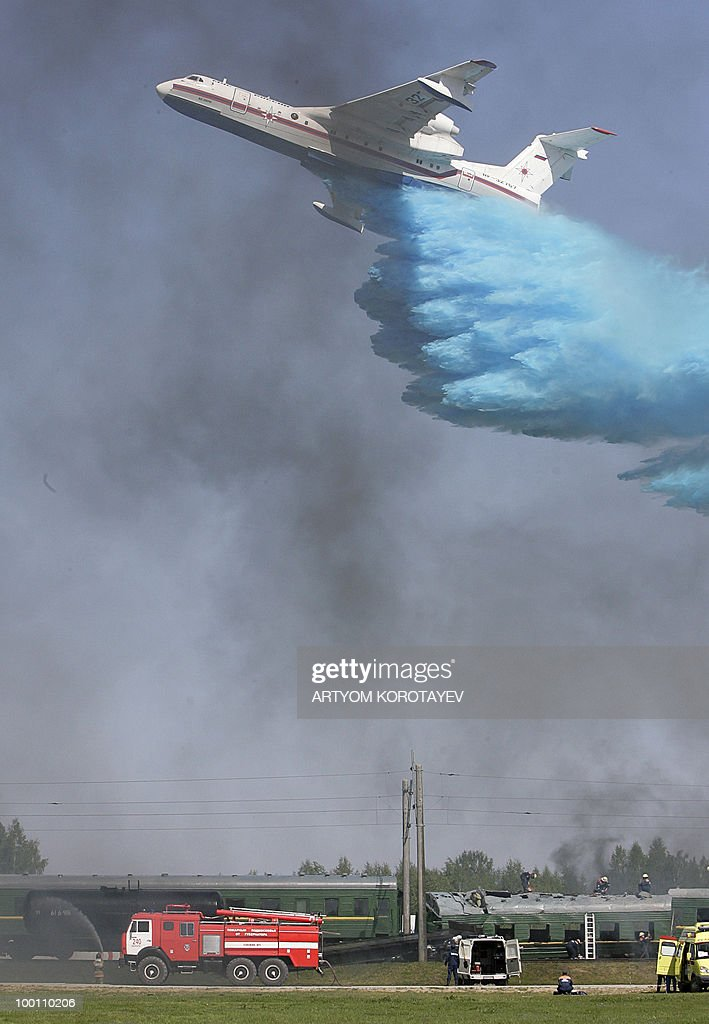 A Russian Emergency Situations Ministry plane dumps water on a fire during a training exercise 60 km from Moscow in Noginsk on May 21, 2010. Various emergency and military special units held a day of training activities.
