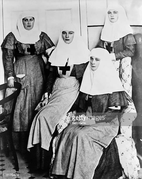 Russian Empress Alexandra sits between her two eldest daughters Olga and Tatiana and Anna Vyrubova