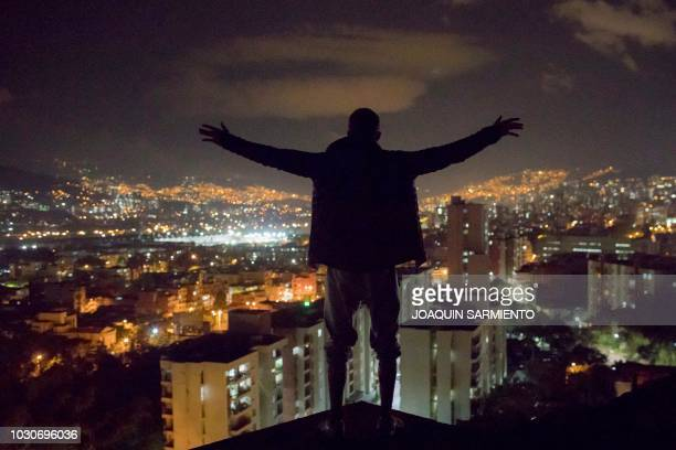 Russian extreme athlete Pavel Gogulan aka the Russian Spiderman looks at the city from a building under construction as he prepares for an upcoming...