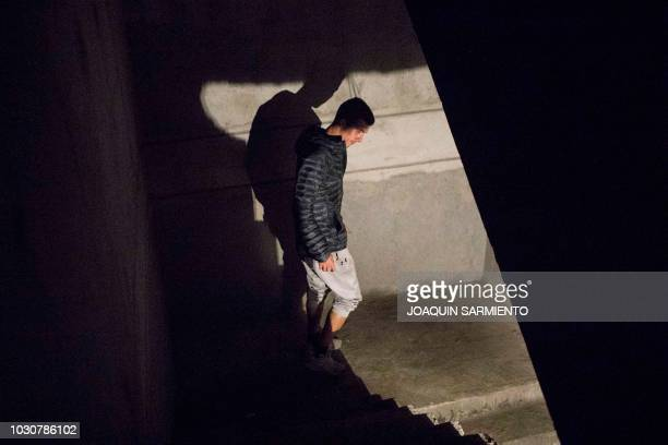 Russian extreme athlete Pavel Gogulan aka the Russian Spiderman walks down after climbing a building under construction as he prepares for an...