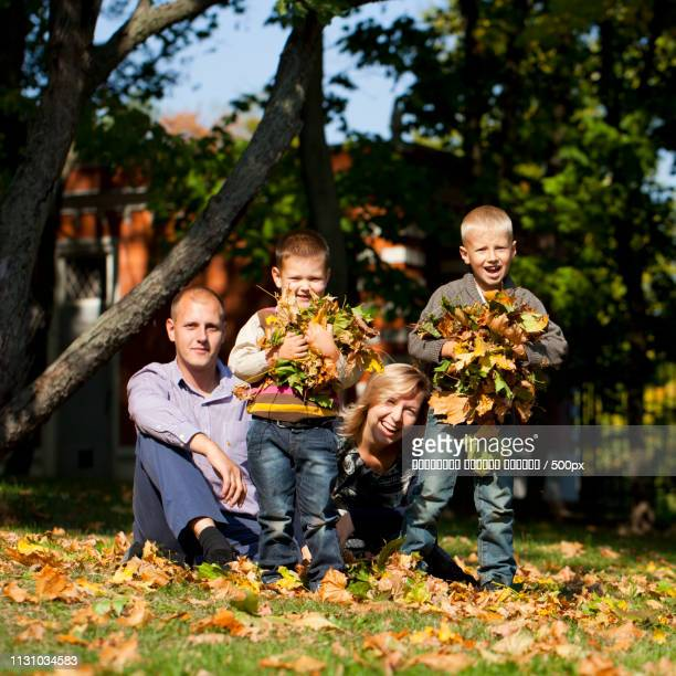 Russian Family, Young Parents And Two Sons