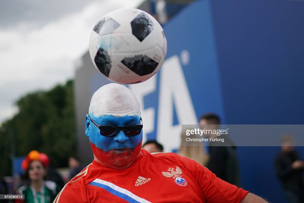 A Russian fan plays football at the official FIFA Fan Fest at Moscow State University where fans will watch the first World Cup game between Russia and Saudi Arabia on June 14, 2018 in Moscow, Russia. FIFA expects more than three billion viewers of the World Cup competition which begins today.