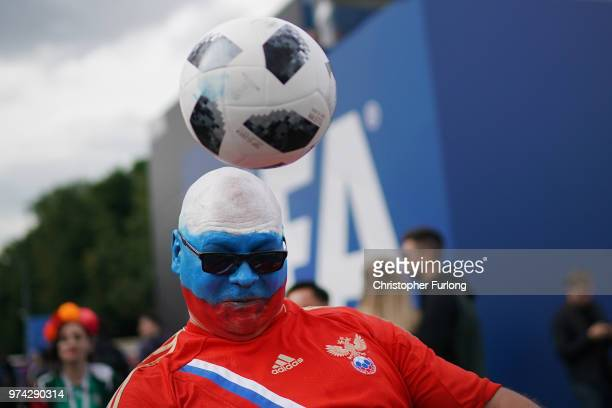 Russian fan plays football at the official FIFA Fan Fest at Moscow State University where fans will watch the first World Cup game between Russia and...
