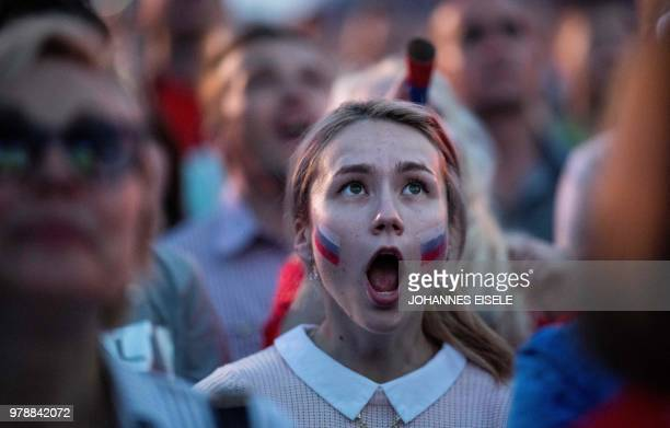 Russian fan reacts as she watches a screening of the Russia 2018 World Cup Group A football match between Russia and Egypt at the Fan Zone in Nizhny...