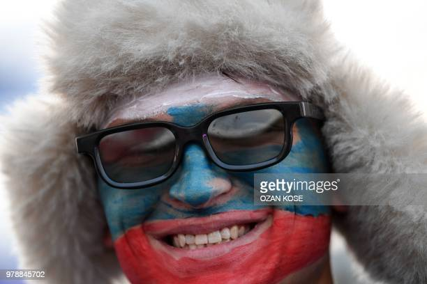 A Russian fan smiles during the Russia 2018 World Cup Group A football match between Russia and Egypt at the Fan Zone in Kaliningrad on June 19 2018