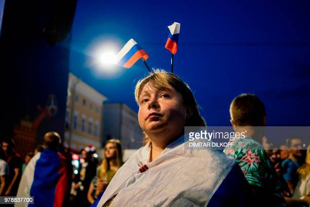 A Russian fan watches her team during the Russia 2018 World Cup Group A football match between Russia and Egypt at the Fan Zone in Nizhny Novgorod on...