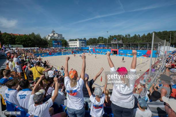 Russian fans celebrate as a goal is scored for the Russian Federation against Spain during the beach soccer first round group B match at the Olympic...