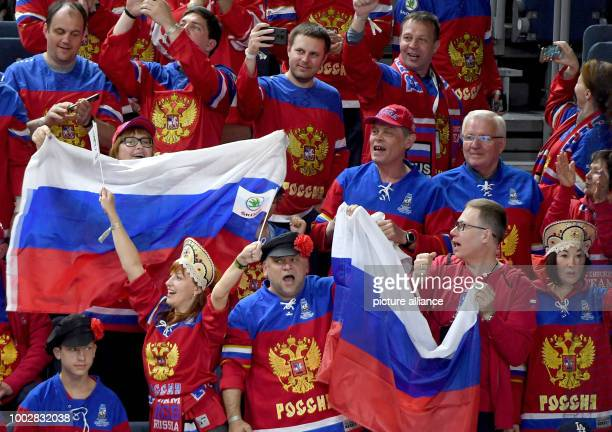 Russian fans cheer their team during the Ice Hockey World Championship thirdplace match between Finland and Russia in the Lanxess Arena in Cologne...
