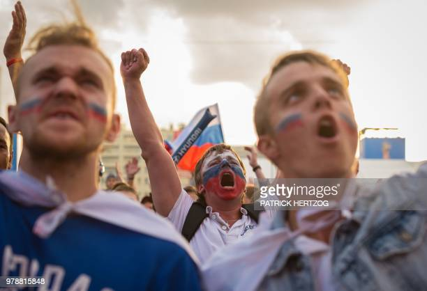 Russian fans cheer their team during the Russia 2018 World Cup Group A football match between Russia and Egypt at the Fan Zone in Kaliningrad on June...